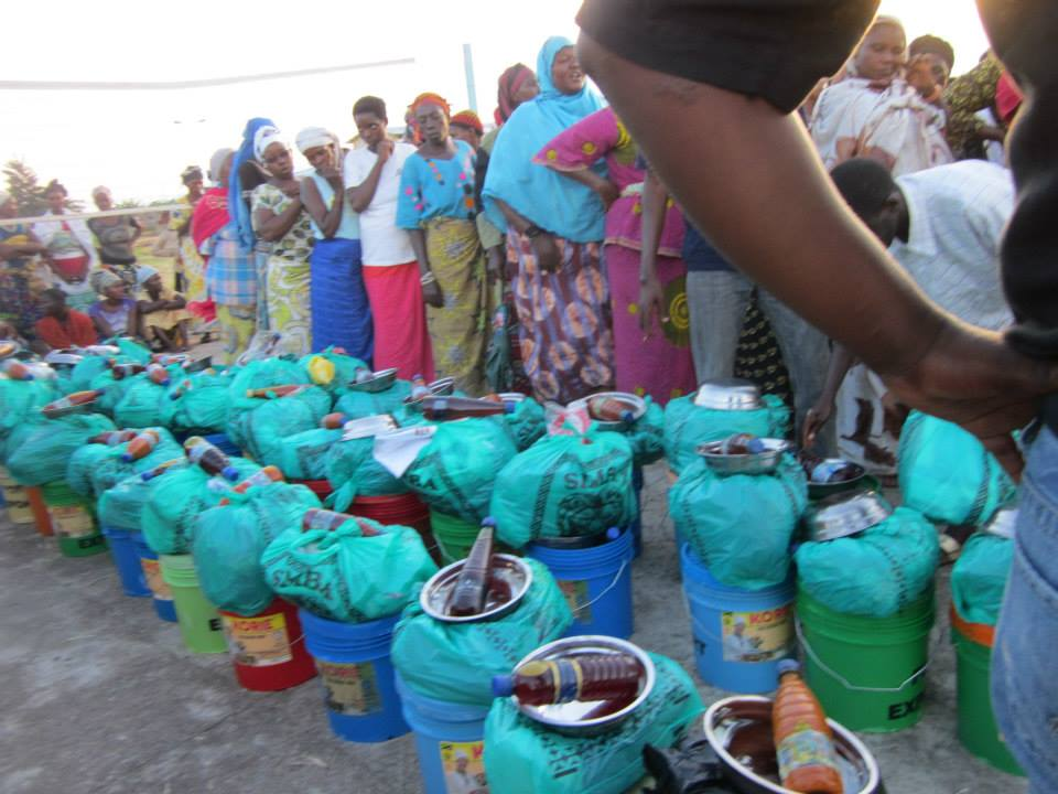 Wings of Hope for Africa distributes emergency relief supplies to Buterere flooding victims, 2014.
