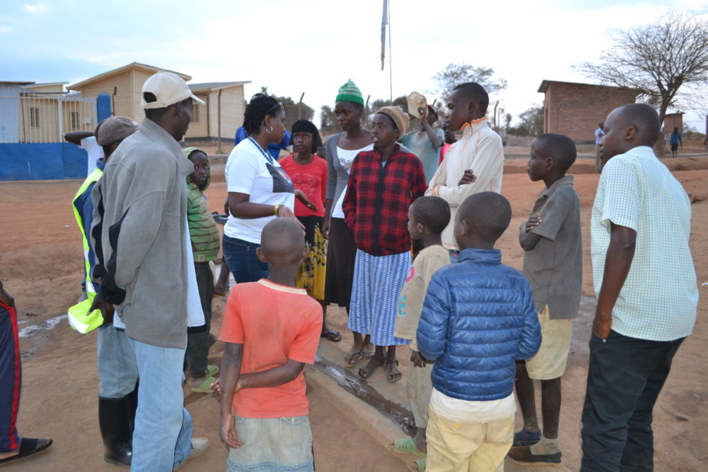 Adult and children refugees arrive at the camp - Mahama Camp - Wings of Hope for Africa Refugee Campaign.  Photo used with permission of International Plan Rwanda (© Plan International)
